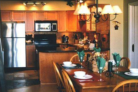 Kitchen and dining area in a Greystone Lodge condo