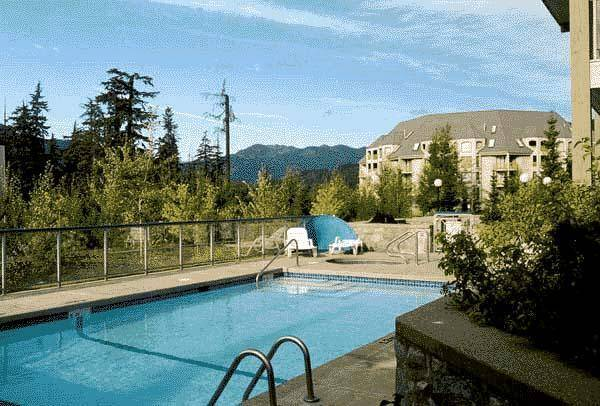 Outdoor common swimming pool at Greystone Lodge