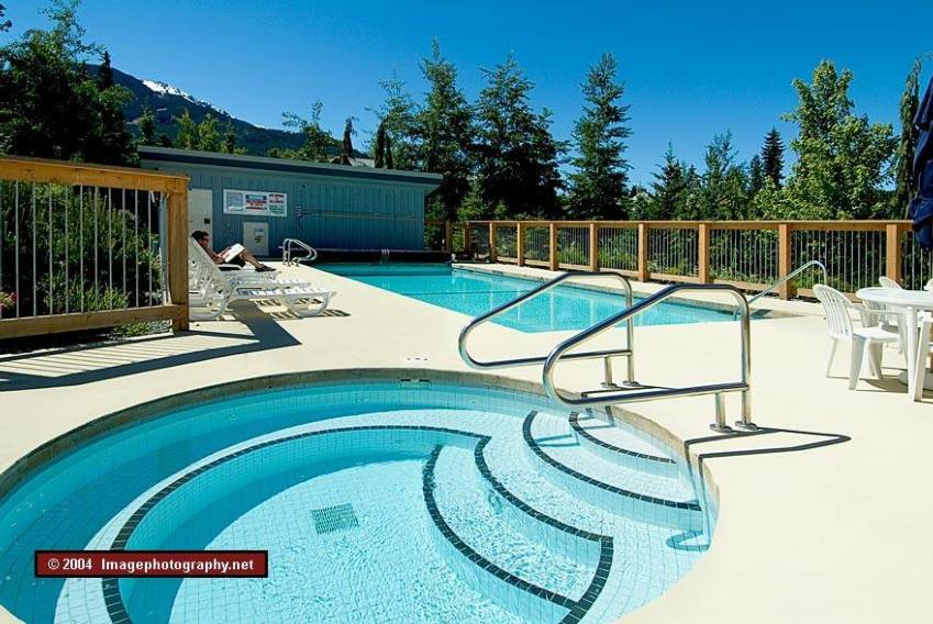 Outdoor pool and hot tub at Whistler Racquet Club near Montebello
