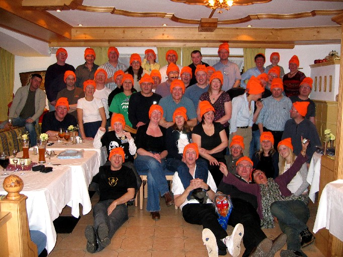 Ski club members in orange hats