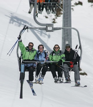 Ski club members on a chair lift
