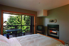 Powderhorn in Whistler master bedroom with fireplace.
