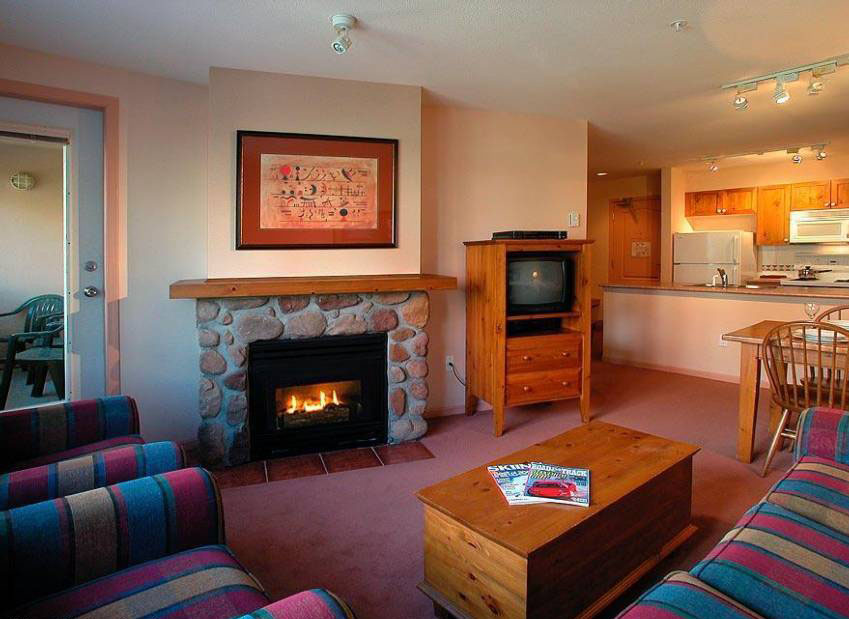 Relax in front of the stone fireplace after a long ski day