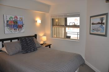 The bedroom features a very comfortable queen size bed, large window for that fresh air, TV and blu-ray / dvd player, double size closet and dresser.