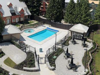 Pool and hot tub courtyard area of Lake Placid Lodge