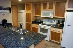 Kitchen with full size washer & dryer
