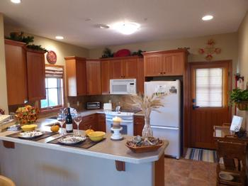 Our spacious, well-equipped kitchen - with patio door leading to back deck with Hot Tub and BBQ