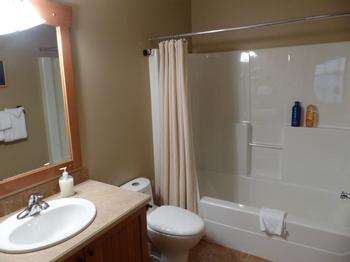 Upper Floor: Main Bath with Bathtub - across from Kids Room