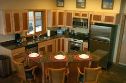 Kitchen with deluxe cabinets and appliances