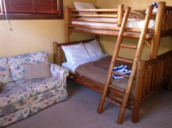 Single over double bunk in second bedroom.