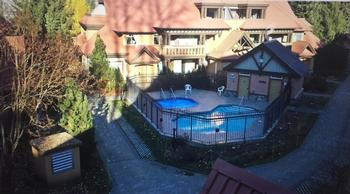 View of complex pool and hot tub from balcony off of queen bedroom