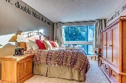 Master bedroom with king/2 twins. Entertainment unit holds LED TV and storage drawers.