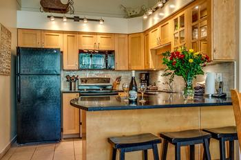 Renovated, fully equipped kitchen with extended eating counter.