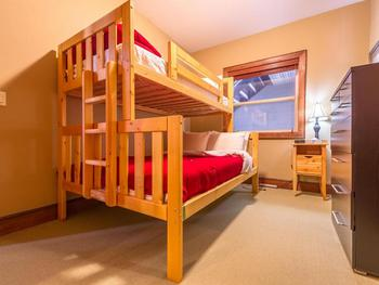 Single over double bunk in the second bedroom.