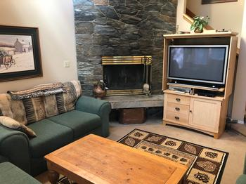 Spacious Living Room seating for 6-8. Wood-burning fireplace. 42 Inch HDTV. Free Wireless.