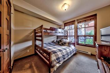 Second bedroom with twin over Queen beds.