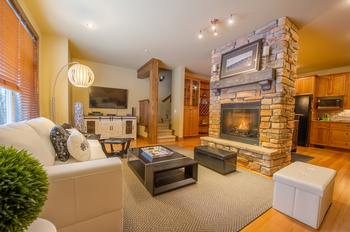 Spacious living room with thermostat controlled gas fireplace.