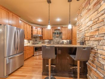 Fully equipped granite countertop kitchen with 2 leather bar stools