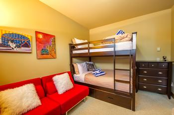 Double over double bunk bed in third bedroom located adjacent to the dining room.