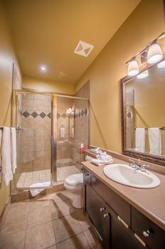 Bathroom with shower and heated floor located on entry level with easy access from hot tub and sauna.