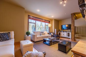 Spacious living room with 54' TV and entertainment system.