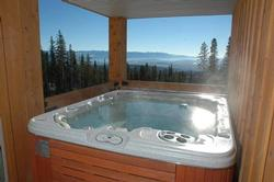 Steaming hot tub right at your private covered deck that offers the incredible views and privacy. Very rare find and must have for your ultimate ski vacation.