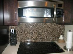 Glass backsplash and Flat top stove