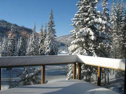 Our huge deck catches powder in the winter and rays in the summer.