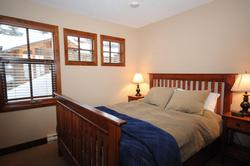 The charming West Bedroom with queen bed.