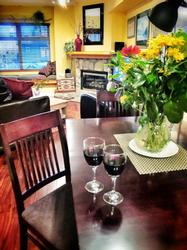 Don't forget that the lights in dining room are on a dimmer so that you can set the mood for a romantic glass of wine. The expandable cherry wood dinging room table has comfy padded seats.