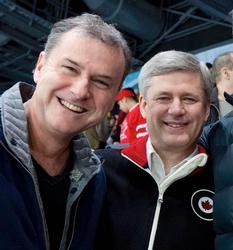 A picture of the owner, with Prime Minister Stephen Harper taken at the 2010 Olympic Winter Games.