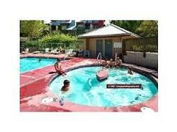 The hot tub is kept a hot 104 degrees. Both the tub and the pool are open year round.