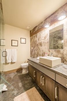 Master en-suite bathroom with steam shower and heated stone floors