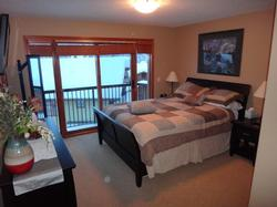 The master bedroom has a queen bed, full ensuite bathroom and a flat screen TV.