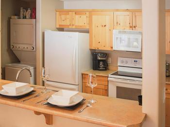 Fully equipped kitchen with washer and dryer nook
