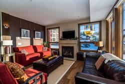 Fabulous open concept corner living room surrounded by a stunning bank of windows. Absolutely the best in natural light allows you to see the wonders of each and every ski and snowboard day. Complete with 50