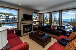 Beautiful open living room with an abundance of natural light. Glance out the windows to see who is coming and going off the Gondola.