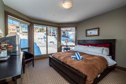 Master Bedroom with the most comfortable king size bed, cotton sheets, duvet and an abundance of pillows. The only reason to get up in the morning is because the ski hill is calling your name!