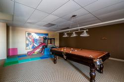 Games Room on the ground level offers an incredible amount of space for the kids to burn off all that extra energy. Equipped with a pool table, ping pong table, toddler climbing stating and couches to sit back and watch some TV
