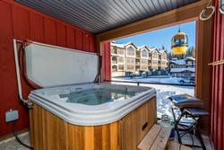 Covered Deck with Hot Tub that seats 8
