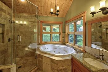 Master ensuite bathroom with jetted jacuzzi tub, two person shower, vanity & views of the mountain.
