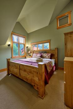 Third bedroom with queen bed, armoire, dresser & views of the dogtooth mountains