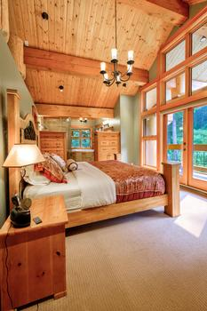 Master bedroom with new king bed, ensuite bathroom & private deck with view.