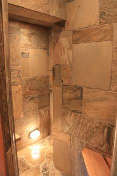 Steam room located off the downstairs bathroom.