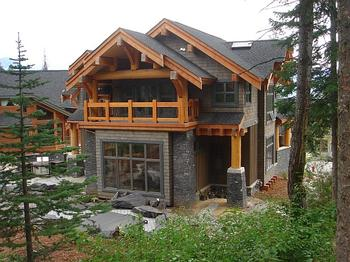 Back View of House with secluded patio backing onto the mountain forest.