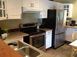 Well Equipped Kitchen with New Appliances Including Induction Range.