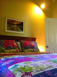 Third Bedroom on the Upper Floor Offers a Queen Sized Bed with Cozy Duvet.