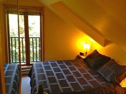 Secluded Loft Bedroom has Ensuite with Shower and Juliet Balcony.