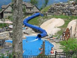 All season pool with slide. What fun for children!