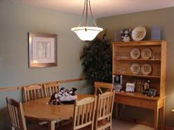 Dining room with more room at the eating bar in the kitchen.